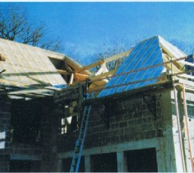 Isolation de toit avec panneaux sandwichs
