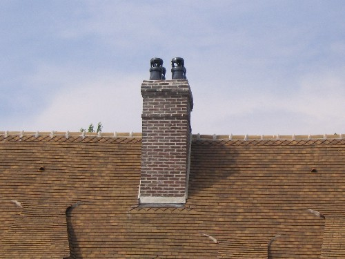 pose de cheminee avec tuiles plates